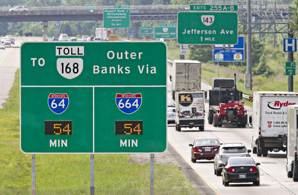 New Reach the Beach traffic information system signs, which show how long it takes to Virginia Beach Oceanfront and 168 toll of Outer Banks, are unveiled on Interstate 64 east bound near Denbigh Boulevard overpass on Wednesday, May 23, 2012.