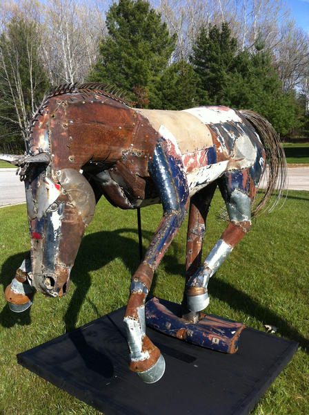 """Mustang"" by Petoskey artist Doug Melvin, is made of reclaimed metal materials from Northern Michigan homesteads."