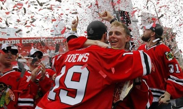 Blackhawks Jonathan Toews and Patrick Kane celebrate the team's 2010 Stanley Cup win during an event on Chicago's Wacker Drive.