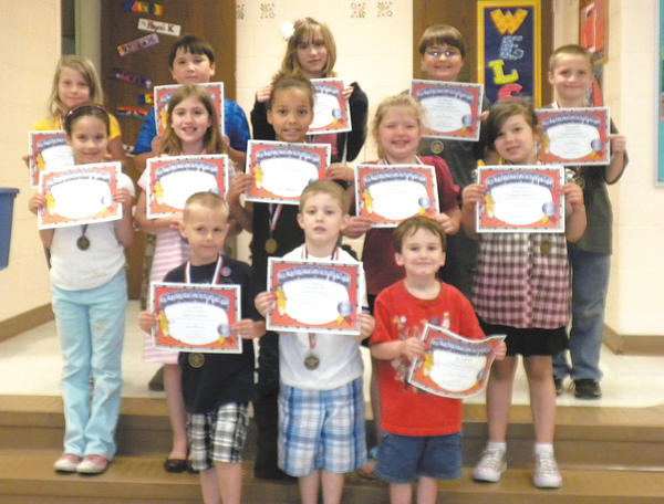 "During May, students were recognized for the character trait of courage at Hickory Elementary School. Students and families were invited to school for a ""pinning ceremony,"" which included certificates, pencils and erasers, followed by ice-cream sundaes and family bingo. First row, from left, Nicholas Anderson, Kadin Mullendore and Colton Hoover. Second row, Sarah Dawson, Mary Frances Troast, Jaaliyah Loudin, Shaylee Lewis and Brianna Koontz. Third row, Molly Hull, Wyatt Heavner, Alexis Obitts, Timothy Ringler and Timothy Brown. Absent from the picture are Dennis Householder and Autumn Thrift."