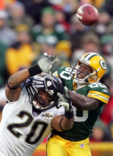 Packers wide receiver Donald Driver, right, can't catch a pass after it was broken up by a Jacksonville defender during this 2004 NFL game.
