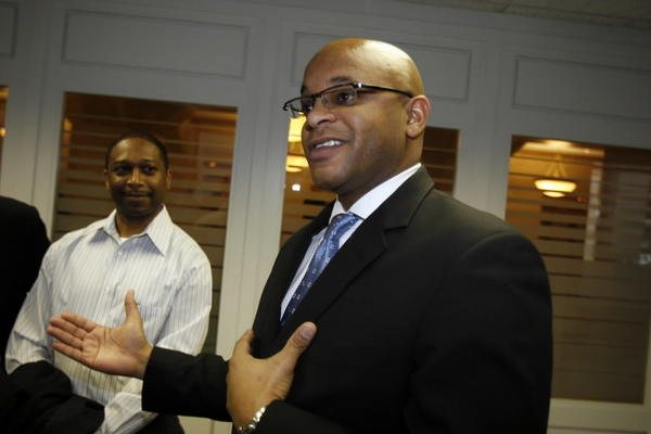 Lance Tyson, seen here being introduced as then-County Board President Todd Stroger's chief of staff in 2006, will run for state representative against indicted Rep. Derrick Smith.