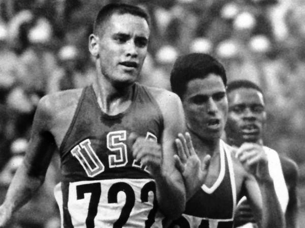 Olympic Games TV moments worth remembering: Billy Mills was raised in poverty on the Oglala Sioux Pine Ridge reservation in South Dakota but became good enough at long-distance running to get a scholarship to the University of Kansas. He was an afterthought, though, in the Olympics 10,000 meters, a race no American had ever won before (or since). It was a surprise when he went into the final backstretch in third place. But it was even more of a shock when he kicked in the final straightaway to sprint to the gold medal in a time 50 seconds faster than he had ever run. Bud Palmer, the play-by-play man, was somewhat sedate in his announcing, but NBC analyst Dick Bank was almost apoplectic, yelling, Look at Mills. Look at Mills. Mills, only the second Native American to win a gold medal, went into the Marine Corps soon afterward, an American hero. Bank � astonishingly, given the hype Olympics TV became � was never employed again as an Olympics broadcaster.
