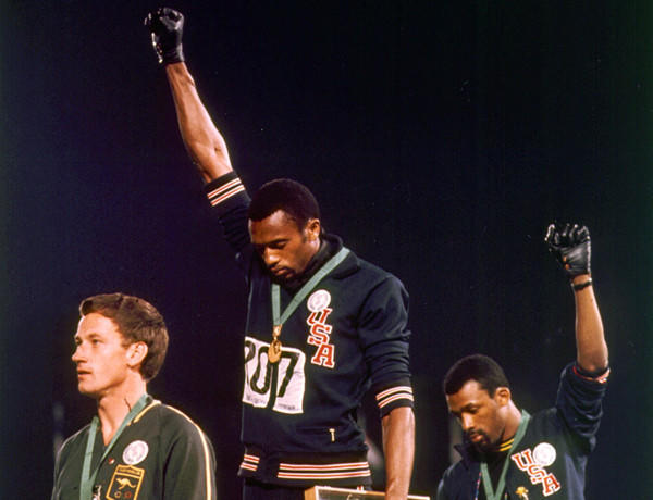 Olympic Games TV moments worth remembering: The Summer Olympics were held in October to escape the searing heat of a Mexico City summer, but it was political heat that marked these games. Martin Luther King Jr. and Bobby Kennedy had been assassinated in the previous months, and Mexican security forces had massacred hundreds of students that summer. In addition, several black athletes had threatened a boycott as a political statement. The 200-meter race was a classic, with Tommie Smith setting a world record. The medal ceremony could have been a mundane moment -- yet it was anything but, as Smith and bronze-medal winner John Carlos bowed their heads and standing barefooted, raised their black-gloved fists in salute as the national anthem played. It was the sign that sports had evolved to where it could be a political and social phenomenon, said Sean McManus, the chairman of CBS Sports, who has also worked for the other two big network sports operations. It catapulted the sports world right off the sports pages.