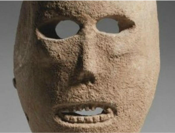 An ancient limestone mask from the Judean desert that is estimated to be 9,000 years old.