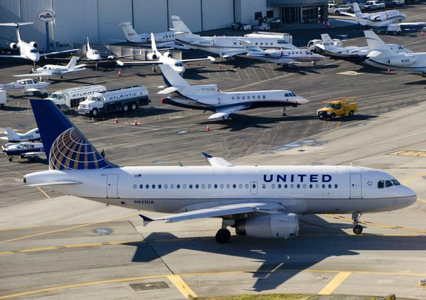 A United Airlines Airbus A319 with a new livery featuring both United and Continental Airlines elements taxis to the runway.  The new paint scheme was designed following a merger between the two carriers.