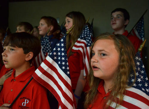 Parkway Elementary School Chorale 5th grader Andi Frimm, 10 sings during the Cub Scout Pack 12, of Allentown second annual ¿Flags on Tilghman¿ at Parkway Elementary School. The ceremony honors the American military this Memorial Day weekend with the placing of  American flags on sections of Tilghman Street.