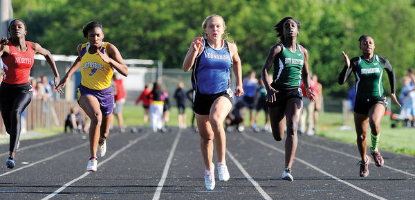 Boonsboro's Abby Duncan, center, sprints to victory in the 100-meter dash earlier this month at the Washington County championships. Duncan will try to win her third straight state titles in the 100 and 200 this weekend.