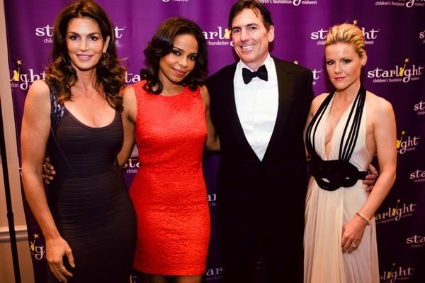 Cindy Crawford (left), Sanaa Lathan (second to left) and Kathleen Robertson (right) pose for a photo with a guest at the Starlight Children's Foundation Midwest's gala at The Standard Club May 19, 2012.