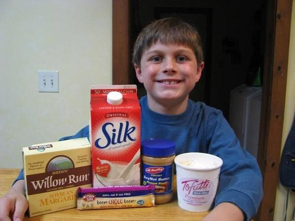 Jason Poquette, 9, of Petoskey, shows off some of the special foods he must eat due to a number of food allergies.