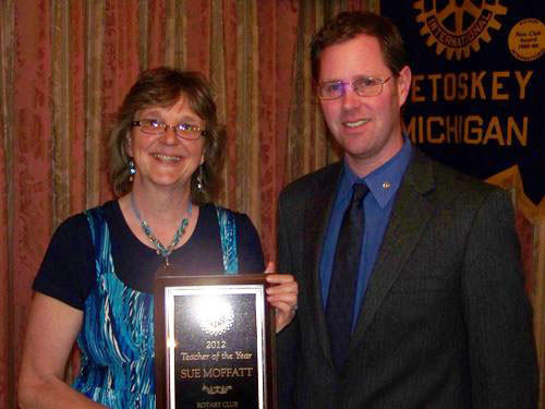 Sue Moffatt, a third grade teacher at Petoskey's Sheridan Elementary, stands with Bill Winslow of the Petoskey Rotary Club. Moffatt received the club's 2012 Teacher of the Year award Wednesday.
