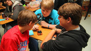 Photo Gallery: Students learn on their cell phones