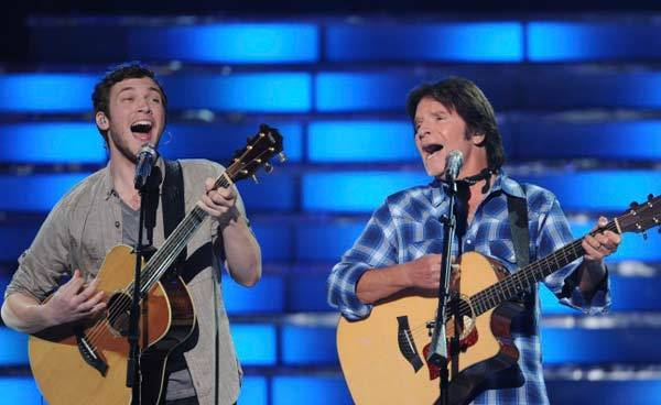 Finalist Phillip Phillps and special guest John Fogerty perform during the season 11 AMERICAN IDOL GRAND FINALE.