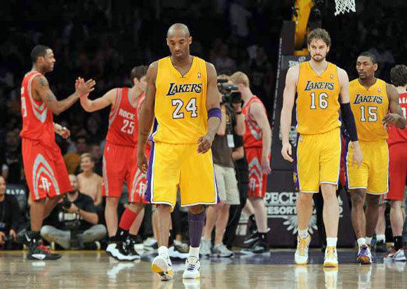 Kobe Bryant, Pau Gasol and Metta World Peace leave the court after a loss to the Houston Rockets in April.