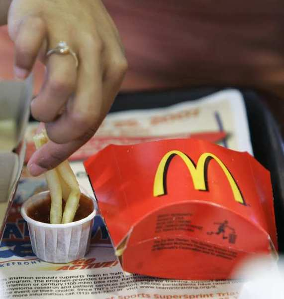 McDonald's executives discussed growth initiatives, including restaurant revamps and menu optimization, at the annual shareholders meeting.