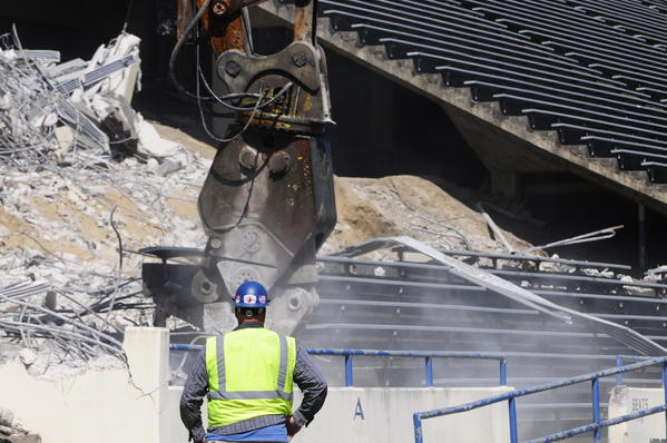 The demolition of UConn's Memorial Stadium continued on Thursday as heavy machinery continued tearing apart the stands.