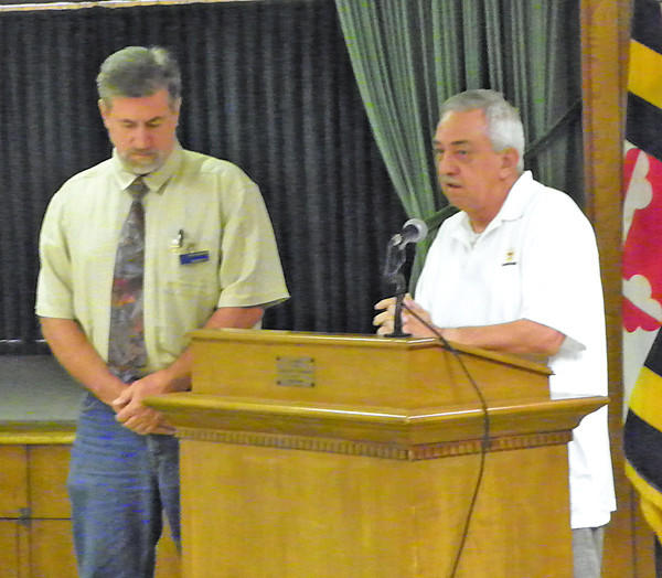 Joseph Bach, right, representing the Mason-Dixon Council of Boy Scouts of America, presents Maugansville Ruritan Club President Chuck Cunningham with an award recognizing the continued support of both a Boy Scout Troop and a Cub Scout Pack. The Ruritan Club has sponsored Scouting for more than 50 years.