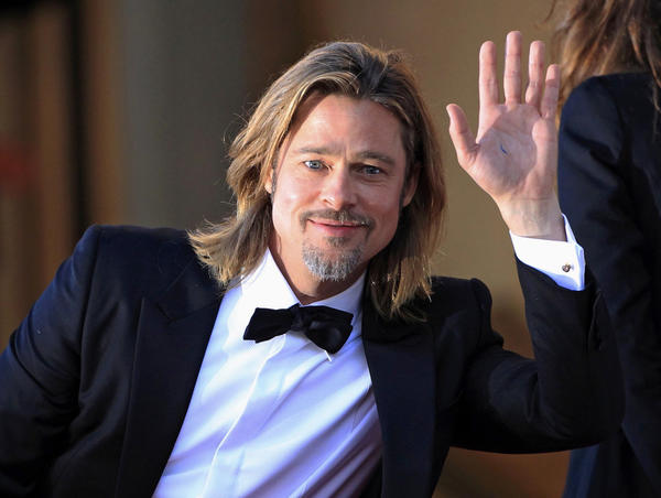"Cast member Brad Pitt arrives on the red carpet ahead of the screening of the film ""Killing Them Softly"", in competition at the 65th Cannes Film Festival, May 22, 2012."
