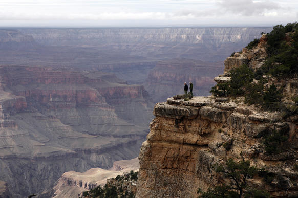 Chris Walker,left, and Kevin Horan look out over the Grand Canyon.