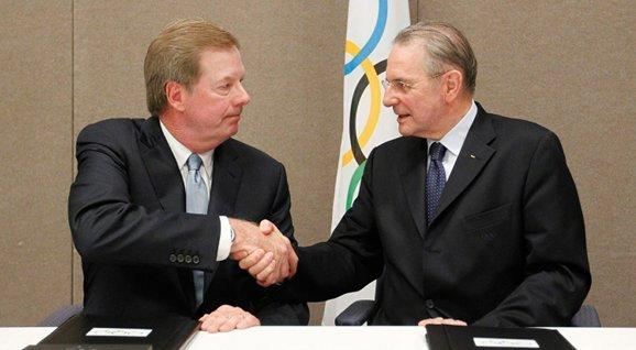 USOC chairman Larry Probst (l) and IOC president Jacques Rogge shake hands after signing a new revenue-sharing agreement between the two organizations Thursday in Quebec City.