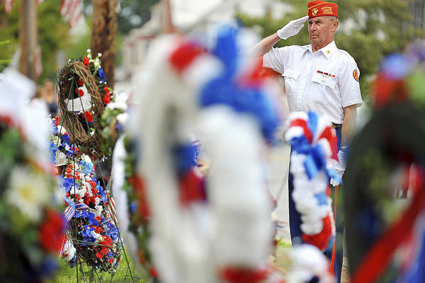 In thie Herald-Mail file photo, Philip Stotelmyer of the Marine Corps League of Hagerstown- Bulldog Detachment salutes after placing one of many wreaths during a wreath-laying ceremony in Sharpsburg.