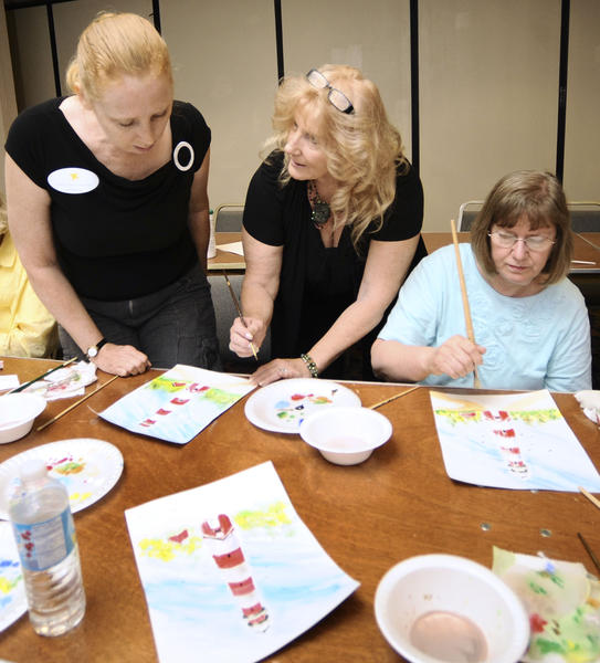 Mary Ellen Tulloch, left, and Kitty Harbaugh, right, take Rebecca Montgomery's, middle, one-hour long art class at the 2012 Senior and Caregivers Expo held Thursday. Montgomery, who currently teaches at various senior centers, says that art benefits seniors by giving a feeling of accomplishment, social contact and even good health.