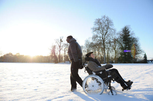 "Francois Cluzet, in wheelchair, and Omar Sy in a scene from ""The Intouchables."""