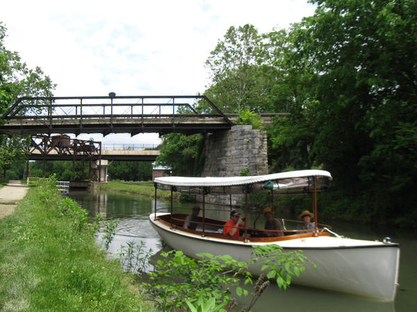 A modern image of the new park canal launch boat operating in the Chesapeake and Ohio Canal National Historical Park at Williamsport.