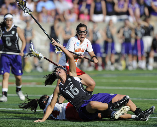 Northwestern's Ali Cassera and Maryland's Iliana Sanza collide during the NCAA Division I women's lacrosse final at Stony Brook. The Wildcats won, 8-7.