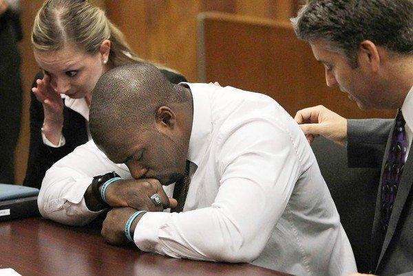 "Brian Banks, with his attorneys, is overcome with emotion in the courtroom. When he heard from the alleged victim last year, ""I stopped what I was doing and got down on my knees and prayed to God to help me play my cards right."""