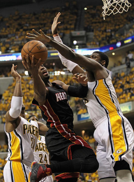 Dwyane Wade #3 of the Miami Heat shoots between David West #21 and Roy Hibbert #55 of the Indiana Pacers in Game Six of the Eastern Conference Semifinals in the 2012 NBA Playoffs at Bankers Life Fieldhouse on May 24, 2012 in Indianapolis, Indiana.