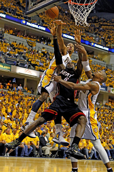 The Miami Heat's LeBron James, middle, is wrapped up by the Indiana Pacers' George Hill and David West in the first quarter in Game 6 of the Eastern Conference Semifinals at Bankers Life Fieldhouse on Thursday, May 24, 2012.
