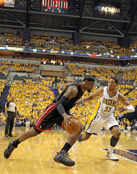 Miami Heat forward LeBron James (6) drives to the basket against Indiana Pacers forward Danny Granger (33) during the first half in game six of the Eastern Conefernce semifinals of the 2012 NBA playoffs at Bankers Life Fieldhouse.