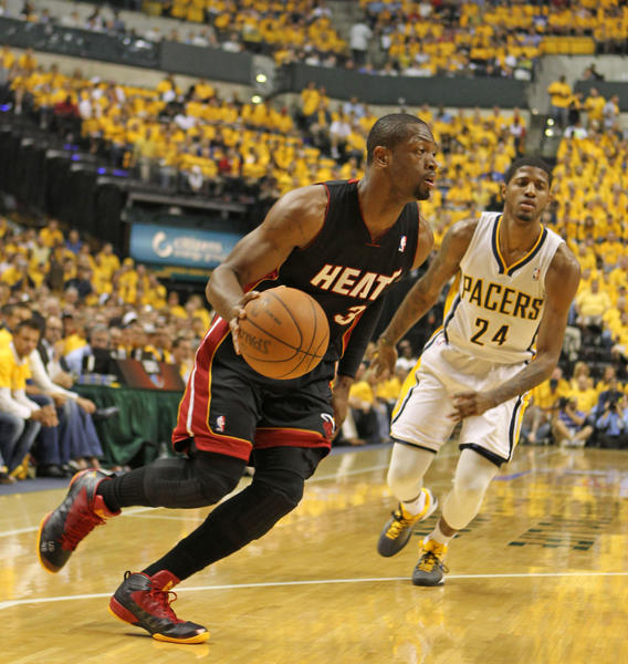 Miami Heat guard Dwyane Wade (5) drives to the basket against Indiana Pacers forward Paul George (24) during the first half in game six of the Eastern Conefernce semifinals of the 2012 NBA playoffs at Bankers Life Fieldhouse.