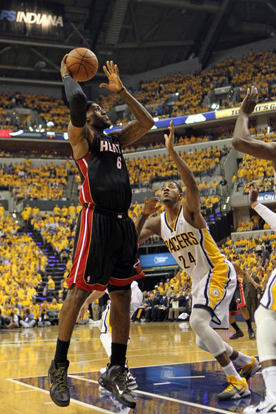 Miami Heat forward LeBron James (6) takes a shot against Indiana Pacers forward Paul George (24) during the first half in game six of the Eastern Conefernce semifinals of the 2012 NBA playoffs at Bankers Life Fieldhouse.