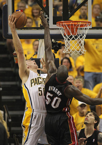 Tyler Hansbrough #50 of the Indiana Pacers is fouled while shooting by Joel Anthony #50 of the Miami Heat in Game Six of the Eastern Conference Semifinals in the 2012 NBA Playoffs at Bankers Life Fieldhouse on May 24, 2012 in Indianapolis, Indiana.