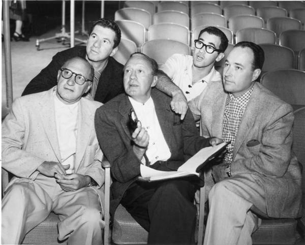 Comedian Jack Benny, center, is surrounded by his writers -- from left, Sam Perrin, Hal Goldman, Al Gordon and George Balzar.