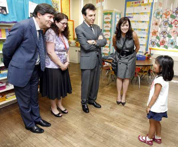Franklin Elementary School kindergartener Emi Moses greets, from left, Italian Cultural Institute's Massimo Sarti, principal Vickie Atikian, Consul General of Italy Giuseppe Perrone and IFLAG Immersion Teacher Specialist Ana Jones during visit to the Italian Immersion Kindergarten Class at the Glendale school.