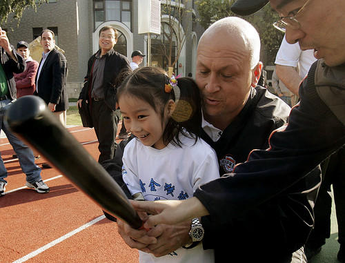 Cal Ripken Jr. instructs a student during a baseball beginner clinic at No. 1 Dahushan Road Elementary School in Shanghai, China.