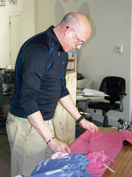 Gary Albert folds shirts.