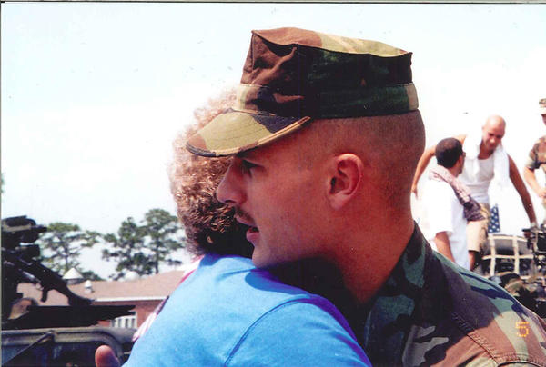Michael Lindemuth hugs his mother, Toni Lindemuth, after the return of his first tour in Iraq in 2003. Lindemuth was killed in action on April 13, 2005.