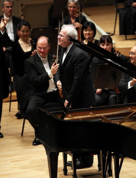 "Pianist Emanuel Ax acknowledges applause before performing Beethoven's ""Emperor"" concerto during the City Piano Festival at Symphony Center in Chicago on Thursday."