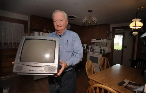 Tom Kelley of South Whitehall returns to a storage room the television set that was ruined by a PPL power surge. PPL has admitted making a wiring error and causing the power surge that damaged four S. Whitehall Twp homes including Kelley's.