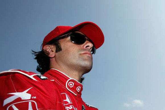 Dario Franchitti prepares to climb aboard his car during practice Friday for the Indianapolis 500.
