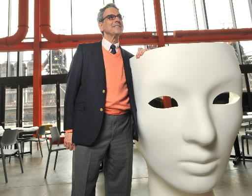 ArtsQuest President Jeff Parks stands beside a novely mask chair inside the new ArtsQuest Center at SteelStacks in south Bethlehem on Monday, April 4, 2011.