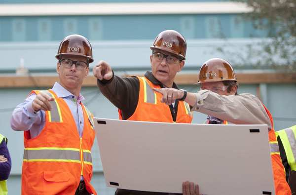 Thomas Staggs, chairman of Disney Parks and Resorts, Robert A. Iger, Walt Disney Co. chairman and chief executive, and Coulter Winn, principal concept architect with Walt Disney Imagineering, during construction of Cars Land in February.