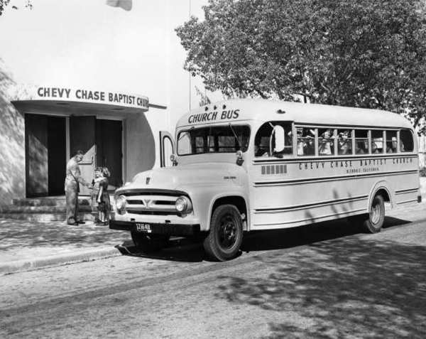 Sunday school students peer out the windows of Chevy Chase Baptist Churchs new bus, purchased in the 1950s. Milton Hall, the contractor who built the new sanctuary in the background, greets some of the children. The church is at the corner of Chevy Chase Drive and Acacia Avenue.