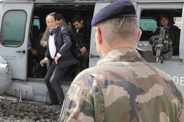 French President Francois Hollande arrives Friday at Forward Operating Base Nijrab in Afghanistan's Kapisa province, where most French troops deployed in the country are stationed.