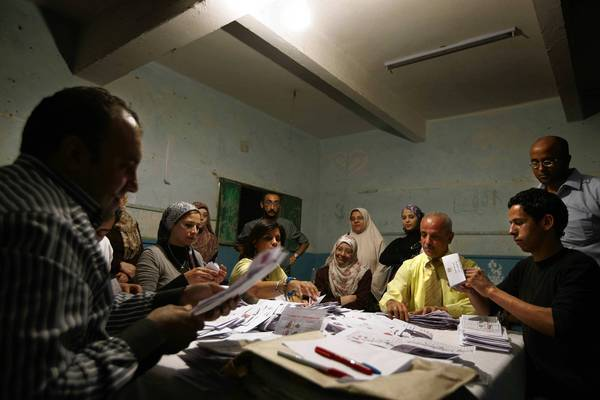 Egyptian election workers count ballots from the presidential election at a school in Cairo.