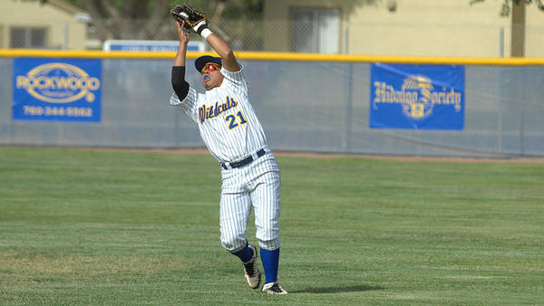 Brawley Union High's Jayson Sanchez catches a fly ball to record an out against Clairemont High during the fifth inning of a CIF-San Diego Section Division III playoff game Friday in Brawley.